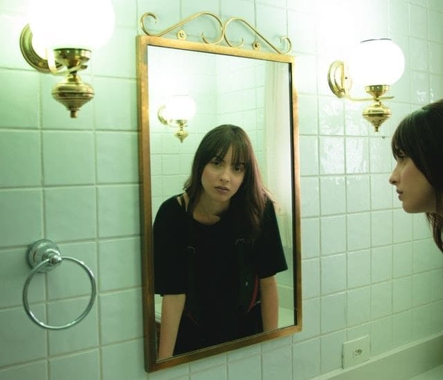 girl looking in mirror